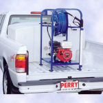 Portable pressure washer unit on truck
