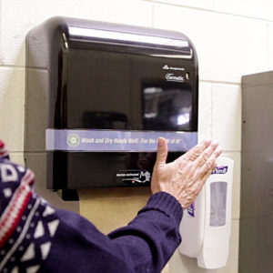 Hands-free paper towel dispenser