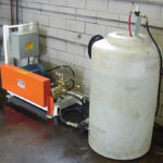Pressure washing system with storage tank